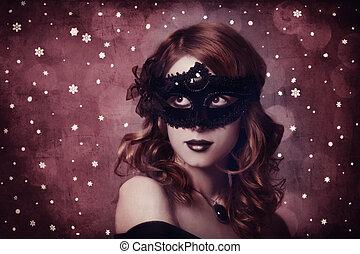 Girl in carnival mask.