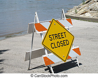 Street Closed - Street closed sign on a flooded road on the...