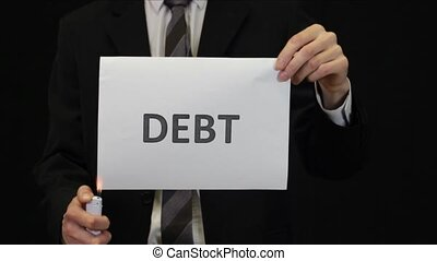 Businessman Burning Debt Sign