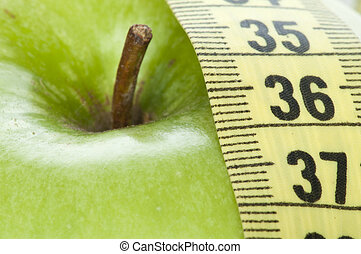Geen apple and centimeter close up