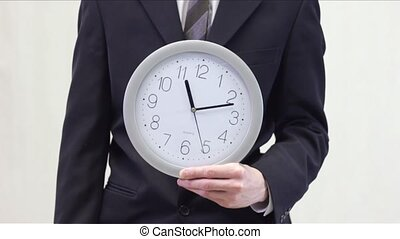 Businessman Shows Time on Clock - 2 - Business man in suit...