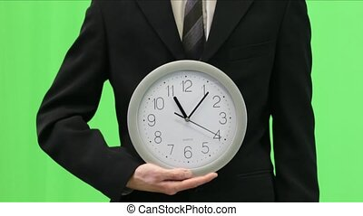 Businessman Shows Time on Clock - 1 - Business man in suit...