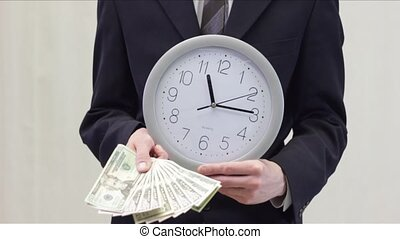Time is Money in Business white - Business man holding...