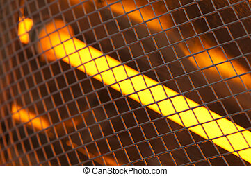 Electric heater with halogen coils close up. Luminous...