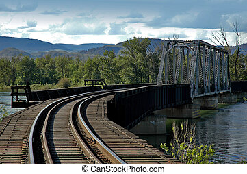 Train Bridge - Train tracks over a train bridge over a river...