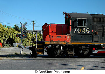 Train Engine at Crossing - A red and black train engine at a...