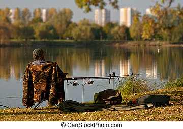 Angler - Patient angler sitting by the pond