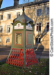 Telephone booth - Antique telephone booth on a street in a...