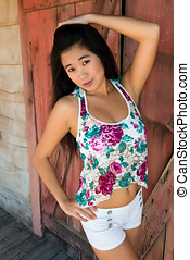 Laotian - Pretty young Laotian woman in a flower print...
