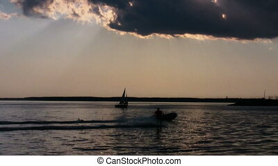 Water skiing at sunset