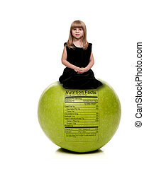 Little Girl on Apple with Nutrition Label