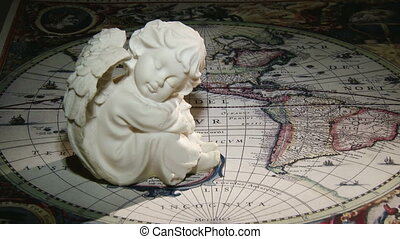 Angel and old map - Guardian Angel, and middle age map