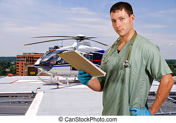 Doctor and Life Flight Helecopter - Man doctor and a mobile...