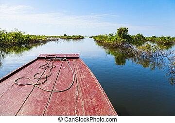 Traveling through Tonle Sap Lake - Boat is navigating...