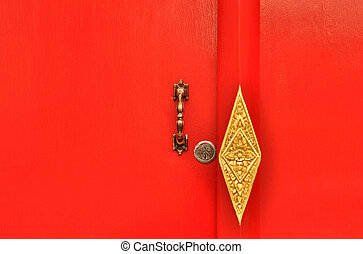 Door handle and Deadbolt lock on red door at Wat Pho