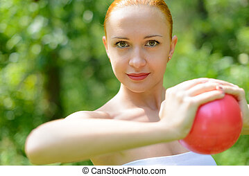 Beautiful woman with fitness ball