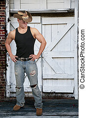 Cowboy - Handsome young country boy man wearing a stylish...