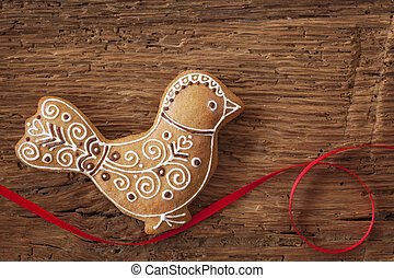 Gingerbread bird cookie on wooden background