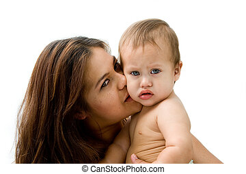 Mother & baby - Mother kissing her baby boy who\\\'s looking...