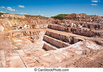 red marble - quarry red marble shot in sunny summer day