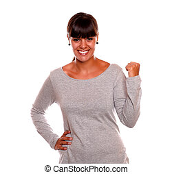 Attractive young woman celebrating a victory - Attractive...