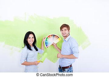 Wall Paint - young couple smile choose palette color pantone...