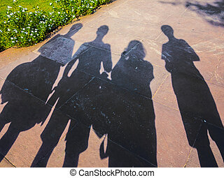 shadows of family visiting a landmark in Delhi, India