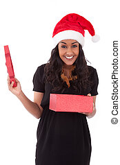 Young African American woman opening a gift box - Young...