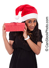 Young African American woman holding gift box