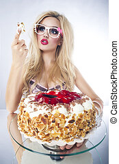Beautiful blonde woman with a cake. Sweet sexy lady with...