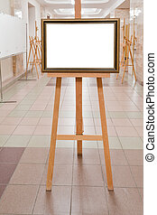 picture frame on easel in art gallery