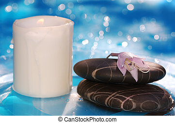 spa stones with candle