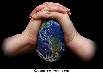 Squeezing the Earth - A pair of hands squeezing the Earth...