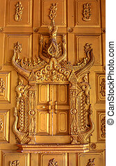 Ancient Golden carving wooden window of Thai temple