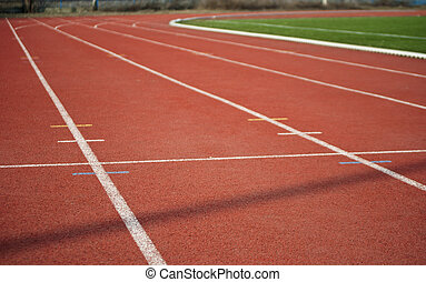 Racetrack - Red athletic track with line.