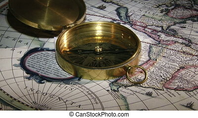 Gold compass, candle, old map - clo