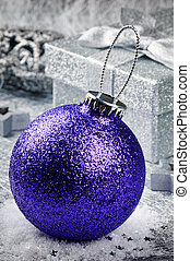 Purple Christmas bauble on silver background