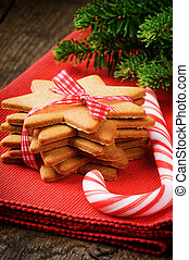 Christmas gingerbread cookies and candy cane on red napkin