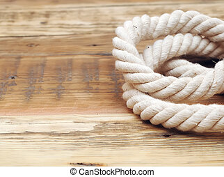 rope on weathered wood background with copy space
