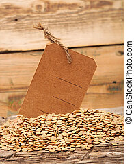 Lentil seeds with blank price tag on a wooden background