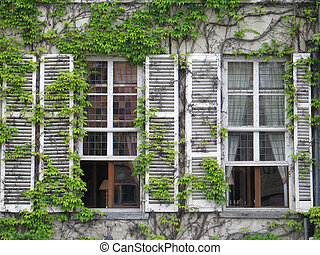 Two old windows in Bruges,  Belgium