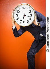 Bureau - Businessman with clock on head, studio shot.