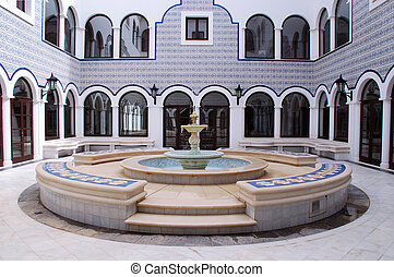 Fountain in arabic patio - Panoramic view of marble fountain...