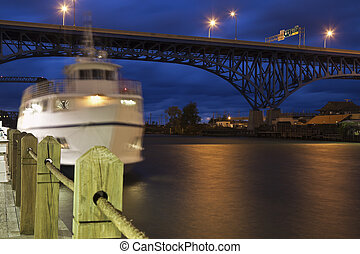 Boat on Cuyahoga River - White boat on Cuyahoga River in...