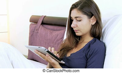 Woman writing email with ipad