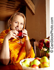 Young woman is drinking tea.