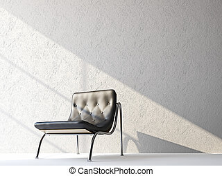 A black leather chair near the wall