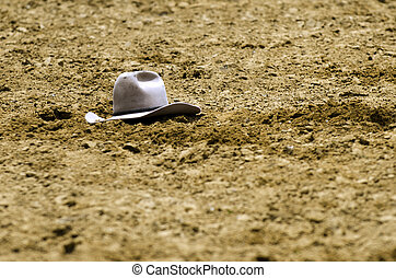 Rodeo - cowboy hat lying on ground.