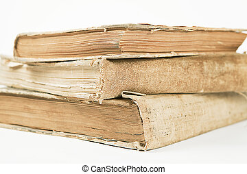 old books - three old antigue books on the white background