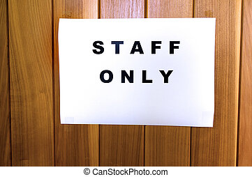 Staff only - A sign reads Staff only in a office door